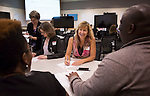 Cheryl Hanzel talks with people at her table during the Discovering Common Ground icebreaker at the Marketing Symposium on November 4, 2015 in Schoonover Center. Photo by Emily Matthews