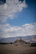 A monastery is seen in the distance in the outskirts in Leh