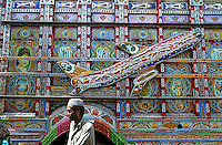 An aeroplane motif on the side of a highly decorated goods truck in a painting workshop in Dina on The Grand Trunk Road.