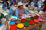 Americas, South America, Peru, Pisac. Market vendor selling colorful pigments.