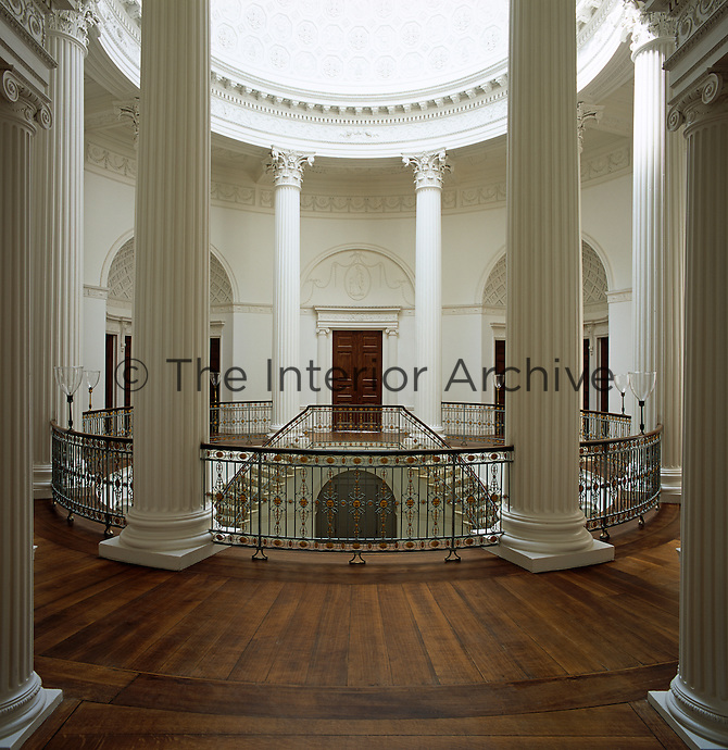 The rotunda features eight columns, ten pairs of mahogany doors and a cantilevered staircase