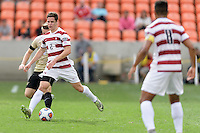 Houston, TX - Friday December 11, 2016: Foster Laangsdorf (2) of the Stanford Cardinal brings the ball up the field against the Wake Forest Demon Deacons at the NCAA Men's Soccer Finals at BBVA Compass Stadium in Houston Texas.