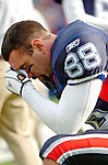13 November 2005: Buffalo Bills tight end Ryan Neufeld says a personal prayer on the sidelines prior to facing the Kansas City Chiefs at Ralph Wilson Stadium in Orchard Park, NY. The Bills defeated the Chiefs 14-3. ..Mandatory Photo Credit: Ed Wolfstein