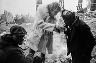 December 1969 --- French actor Yves Renier lights the cigarette of a homeless man in a rundown area of New York City. --- Image by © JP Laffont