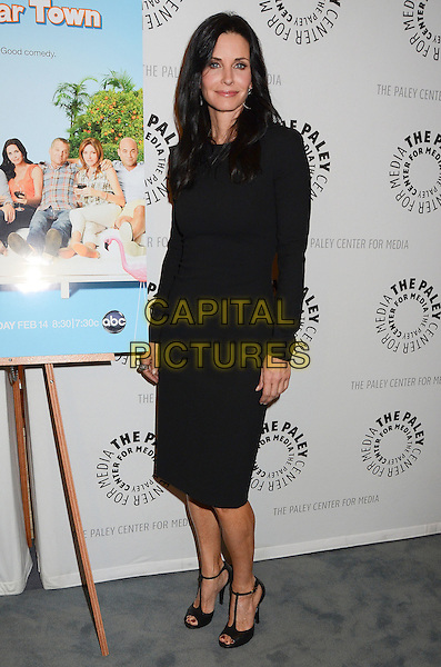 Courteney Cox.'Cougar Town' Special Premiere Screening held at The Paley Center for Media, Beverly Hills, California, USA..February 8th, 2012.full length black dress ankle strap t-bar peep toe shoes long sleeves .CAP/ADM/BT.©Birdie Thompson/AdMedia/Capital Pictures.