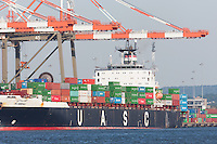 United Arab Shipping Company container ship Al-Abdali is loaded at the Maher Terminals container terminal facility in the Port Newark-Elizabeth Marine Terminal in Newark Bay.