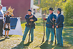 Old Bethpage, New York, U.S. 29th September 2013.  ROBERT WALKER, of Coram, 2nd from right, and other Civil War re-enactors, talk with visitors at The Long Island Fair, held at Old Bethpage Village Restoration. A yearly event since 1842, and now held at a reconstructed fairground based on the original in Mineola, the Long Island Fair continues as the only county fair sanctioned by New York State for the counties of Queens, Nassau and Suffolk.