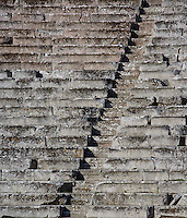 EPIDAURUS, GREECE - APRIL 15 : A detail of a Diazoma cutting through the seating in the Cavea of the Theatre, on April 15, 2007 in Epidaurus, Greece. The Theatre, designed by Polykleitos the Younger, was built in the late 4th century BC and extended in the Hellenistic period. It was rediscovered in 1881 and significantly restored in the 1950s.  It has the three main features of a Greek theatre: the orchestra, the skene, and the cavea, a raked semi-circular auditorium with radiating diazomas. The theatre is renowned for its accoustics thanks to the symmetry of the cavea, seen here in the early morning light. (Photo by Manuel Cohen)