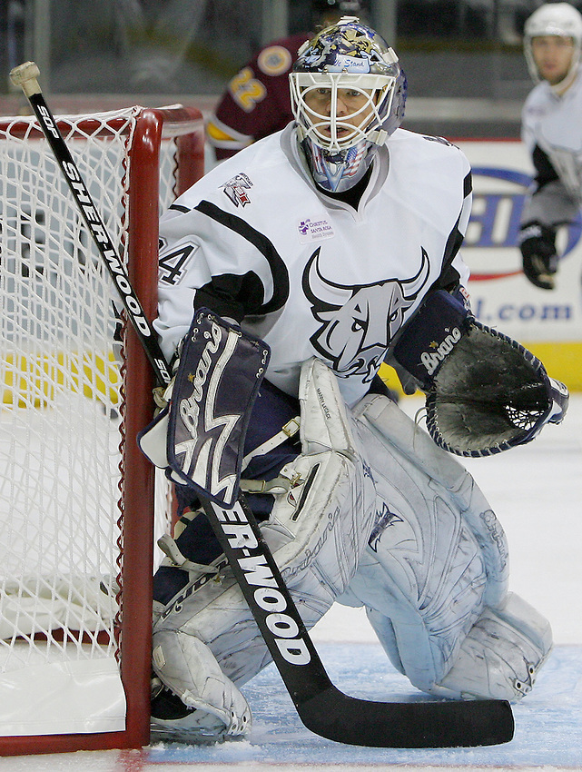 San Antonio Rampage goaltender Manny Legace watches play during the first period of an AHL hockey game against the Chicago Wolves, Saturday, Oct. 8, 2011, in San Antonio. (Darren Abate/pressphotointl.com)