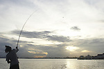 Fisherman casting into the Suriname River in the capital city of Paramaribo, Suriname.
