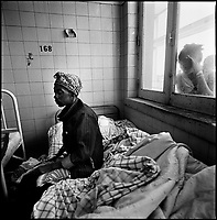 Huambo, Angola, May, 24, 2006.Alice, 30, is HIV positive. More than 300 TB patients live in Huambo State Sanatorium, hundreds more are outside patients. TB is endemic in the region, fueled by poverty, malnutrition, inadequate hygiene and the rapid spreading of HIV/AIDS since the end of the civil war in 2002.