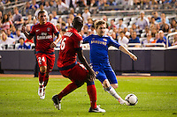 Marko Marin (21) of Chelsea FC is defended by Zoumana Camara (6) of Paris Saint-Germain. Chelsea FC and Paris Saint-Germain played to a 1-1 tie during a 2012 Herbalife World Football Challenge match at Yankee Stadium in New York, NY, on July 22, 2012.