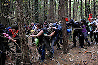 Climate activists make their way through the woods as they take direct action against the coal fired power station at Ratcliffe on Soar, south of Nottingham. The power station, owned by E.ON, is the third largest emitter of greenhouse gases in the UK.