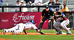 2 March 2010: New York Mets' center fielder Jesus Feliciano dives safely back to first as Atlanta Braves' first baseman Eric Hinske awaits the throw from the pitcher during the Opening Day of Grapefruit League play at Tradition Field in Port St. Lucie, Florida. The Mets defeated the Braves 4-2 in Spring Training action. Mandatory Credit: Ed Wolfstein Photo