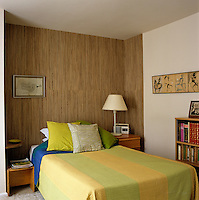 The feature wallpaper at the head of the bed gives the wall of this bedroom a textured appearance