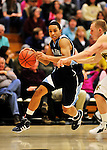 16 January 2012: University of Maine Black Bears' guard Justin Edwards, a Freshman from Whitby, Ontario, in action against the University of Vermont Catamounts at Patrick Gymnasium in Burlington, Vermont. The Catamounts defeated the Black Bears 79-65. Mandatory Credit: Ed Wolfstein Photo