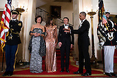 US President Barack Obama (R) and First Lady Michelle Obama (2L) pose for the official picture with Italian Prime Minister Matteo Renzi (2R) and Italian First Lady Agnese Landini (L) prior to the state dinner at the White House in Washington DC, USA, 18 October 2016. President Obama and First Lady Michelle Obama are hosting their final state dinner featuring celebrity chef Mario Batali and singer Gwen Stefani performing after dinner. <br /> Credit: Shawn Thew / Pool via CNP