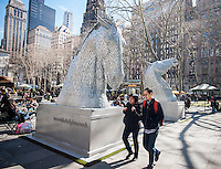 """Two 15 foot tall horse head sculptures are seen displayed in Bryant Park in New York on Friday, March 21, 2014. The sculpture is part of the Tartan Week activities which celebrate all things Scottish. The horse heads are 1:10 scale miniatures of """"The Kelpies"""", monumental 100 foot tall sculptures, the largest equine sculptures in the world, by the artist Andy Scott which are displayed in the Helix in Falkirk, Scotland. The horses depict supernatural water horses from Celtic folklore. Tartan Week in New York concludes with the Tartan Day Parade. (© Richard B. Levine)"""