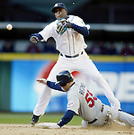 Minnesota Twins' Mike Redmond (55) is forced out at second base by Seattle Mariners shortstop Yuniesky Betancourt s he turns a double play in the seveth inning at Safeco Field in Seattle on April 19, 2007. Twins' Josh Rabe hit into the double play. The Twins beat the Mariners 6-5.  (UPI Photo/Jim Bryant).