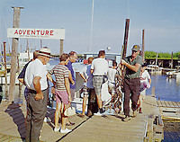 Retro Fishing Boat Dock Photograph from 1959. Captain with the catch of the day in Myrtle Beach, SC.