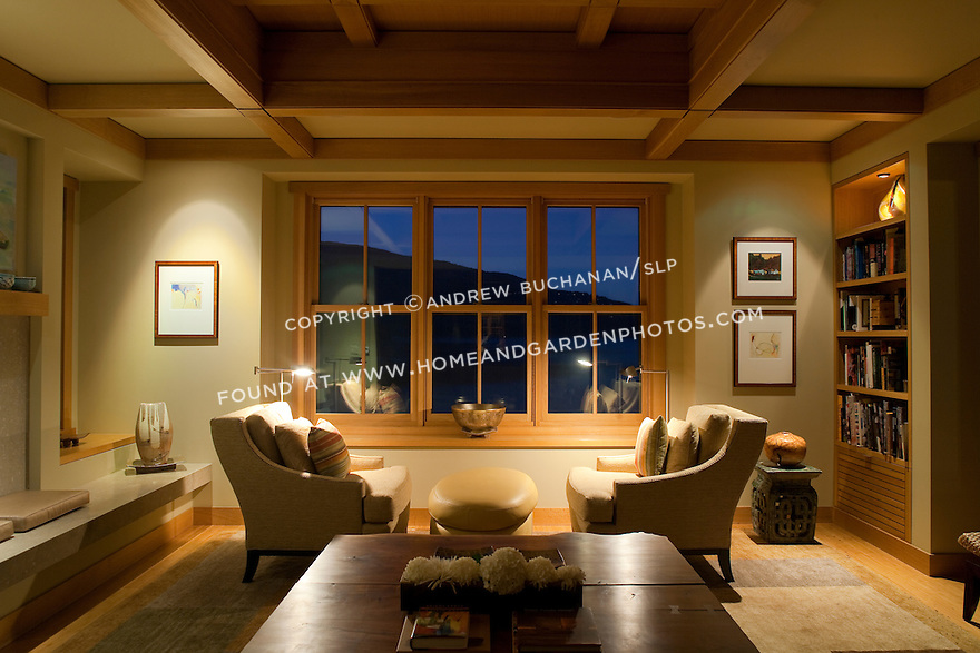 Natural wood trim, built-ins and box beam ceiling provide warm accents in this Pacific Northwest living room. this image is available through an alternate architectural stock image agency, Collinstock located here: http://www.collinstock.com