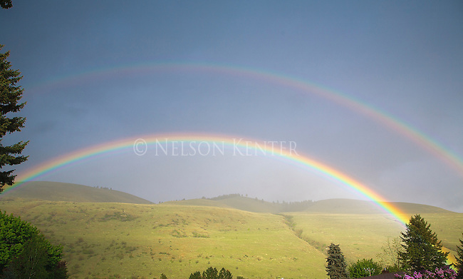 a double rainbow and mount sentinel on a summer evening in missoula, montana