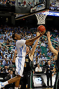 Desmond Hubert attempts to make a layup but is blocked by Vermont defense. UNC defeated Vermont 77-58 during the 2nd round of the 2012 NCAA Basketball Championship at the Greensboro Coliseum in Greensboro, NC. Photo by Al Drago.