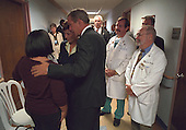 United States President George W. Bush and First Lady Laura Bush comfort family members of patients wounded in the attack on the Pentagon at Washington Hospital Center, Washington, D.C., Thursday, September 13, 2001. .Mandatory Credit: Eric Draper - White House via CNP.