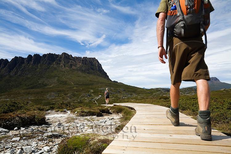 A man hikes the Overland Track at Cradle Mountain.  Cradle Mountain-Lake St Clair National Park, Tasmania, AUSTRALIA