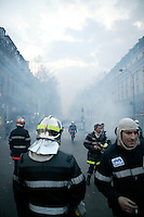 25 March 2004 - Paris, FRA - Firefighters pull back from a cloud of tear-gas in Paris, France, 25 March 2004. The firefighters earlier marched through the city to demand that their profession be classified as a dangerous occupation which entails various social security benefits including early retirement. The confrontation with riot police left 2 firefighters and 20 policemen injured.