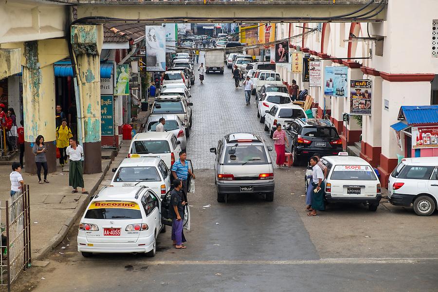 YANGON, MYANMAR - CIRCA DECEMBER 2013: View of lateral street of the BoGyoke Aung San Market in Yangon.
