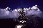 The eyes of Buddha peer out from beneath giant Himalayan Mountains in the Sagarnatha National Park, Nepal.