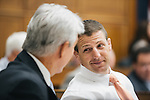 Congressman Markwayne Mullin talks with congressman Roger Williams of Texas during the Transportation and Infastructure committee's meeting on Sept. 19, 2013. During the meeting, the committee passed the Water Resources Reform and Development Act of 2013, a bipartisan bill.