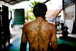 """Tattoos of Kampuchea, which is Cambodia in Khmer, and images of the temple, Angkor Wat on the back of Tuy Sobil, 34, or known as """"KK,"""" who grew up in Long Beach, Ca., created Tiny Toones, a break-dancing youth center, in 2004, in Phnom Penh, Cambodia, on Wednesday, April 21, 2010. The center provides mentoring and educational classes, along with hip-hop music writing and breakdancing classes, for at-risk youth."""