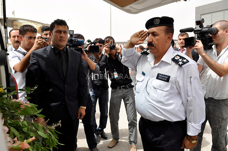 SULAIYMANIYAH, IRAQ:  Sulaimaniyah police officers salute the caskets of the foreigners killed in the Soma Hotel fire as they prepare to load the bodies onto the airplanes.<br /> <br /> On July 15, 2010 a fire in the Soma Hotel killed around 40 people including women, children and internationals from the US, Britain, Canada, Australia, Venezuela, Lebanon, South Africa, Bangladesh, the Philippines, Sri Lanka, and Cambodia..Photo by Aram Karim/ Metrography