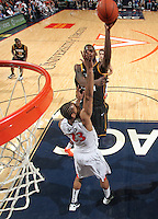 CHARLOTTESVILLE, VA- DECEMBER 6: Mike Morrison #22 of the George Mason Patriots shoots over Mike Scott #23 of the Virginia Cavaliers during the game on December 6, 2011 at the John Paul Jones Arena in Charlottesville, Virginia. Virginia defeated George Mason 68-48. (Photo by Andrew Shurtleff/Getty Images) *** Local Caption *** Mike Scott;Mike Morrison