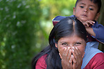A child on her back, a woman listens during a workshop at an eco-agricultural training center in Comitancillo, Guatemala. The center is sponsored by the Maya Mam Association for Investigation and Development (AMMID).