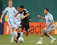 Cristian Castillo #12 of D.C. United rushes past Pablo Mastroeni #25 of the Colorado Rapids during an MLS match on May 15 2010, at RFK Stadium in Washington D.C. Colorado won 1-0.