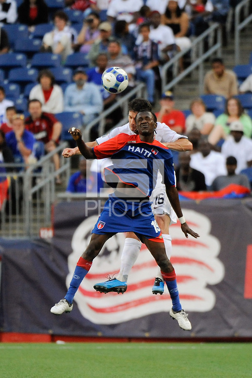 Vaniel Sirin (19) of Haiti (HAI) and Jay Heaps (16) of the United States (USA). The United States and Haiti played to a 2-2 tie during a CONCACAF Gold Cup Group B group stage match at Gillette Stadium in Foxborough, MA, on July 11, 2009. .