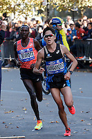 NEW YORK, NY - NOVEMBER 6 ,2016. Hiroyuki Yamamoto of Japan (R) and Hiroyuki Yamamoto of United Sates run before they  wins the fourth and Fifth place at the TCS NYC Marathon men's race in New York November 06, 2016 (Photo by Kena Betancur/VIEWpress)