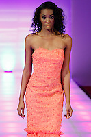 Model walks runway in an outfit from the Nonye Lumm Couture collection by Nonyelum Okonkwo, during Couture Fashion Week Fall 2014, in New York City, February 14, 2014.