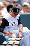26 August 2007:  Colorado Rockies Manager Clint Hurdle takes notes in the dugout during a game against the Washington Nationals at Coors Field in Denver, Colorado. The Rockies defeated the Nationals 10-5 to sweep the 3-game series...Mandatory Photo Credit: Ed Wolfstein Photo