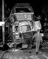 Badly-damaged double-decker bus which exploded outside the premises of C&amp;A in Donegal Place, Belfast, N Ireland, 14th December 1973. The vehicle was hijacked on the Glen Road, West Belfast, and the driver was forced to drive it into the city centre. Note the advertising slogan &ldquo;Contentment comes when you invest in Ulster Savings&rdquo;.  197312140766a<br />