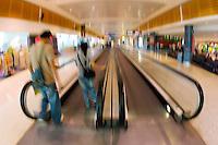 Commuters on an airport conveyor belt , Australia