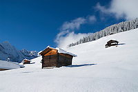 Mountain Barns on snow covered slopes of Gimmelwald in Swiss Alps