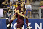 06 December 2013: Virginia Tech's Ashley Manning (12) celebrates her goal with teammate Shannon Mayrose (4). The Florida State Seminoles defeated the Virginia Tech University Hokies 3-2 at WakeMed Stadium in Cary, North Carolina in a 2013 NCAA Division I Women's College Cup semifinal match.