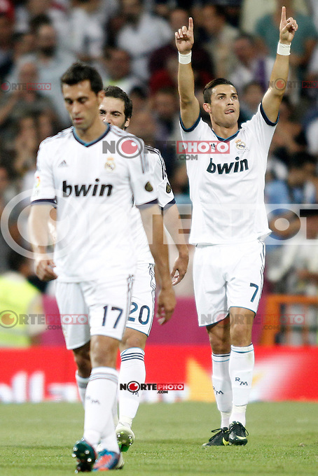 Real Madrid's Ronaldo celebrates his goal  and Barcelona's  during Super Copa of Spain on Agost 29th 2012...Photo:  (ALTERPHOTOS/Ricky) Super Cup match. August 29, 2012. <br />