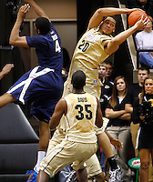 WEST LAFAYETTE, IN - DECEMBER 01: A.J. Hammons #20 of the Purdue Boilermakers reaches for a rebound against Travis Taylor #4 of the Xavier Musketeers at Mackey Arena on December 1, 2012 in West Lafayette, Indiana. Xavier defeated Purdue 63-57. (Photo by Michael Hickey/Getty Images) *** Local Caption *** A.J. Hammons; Travis Taylor