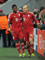 FUSSBALL   CHAMPIONS LEAGUE   SAISON 2011/2012   ACHTELFINALE RUECKSPIEL     13.03.2012 FC Bayern Muenchen - FC Basel        JUBEL nach dem TOR David Alaba (li,)  mit Arjen Robben (FC Bayern Muenchen)