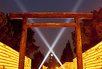 A large torii gate is illuminated by search lights walls of yellow lanterns, each containing the name of a fallen serviceman, during the Mitama matsuri in remembrance of Japan`s war dead at the controversial Yasukuni Shrine in Tokyo, Japan. Sunday, July 13th 2008